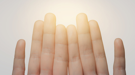 body parts: gesture, family, count and body parts concept - close up of hands showing eight fingers