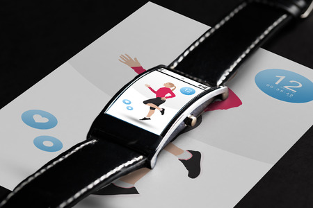sport object: modern technology, sport, object and media concept - close up of black smart watch with fitness application on screen