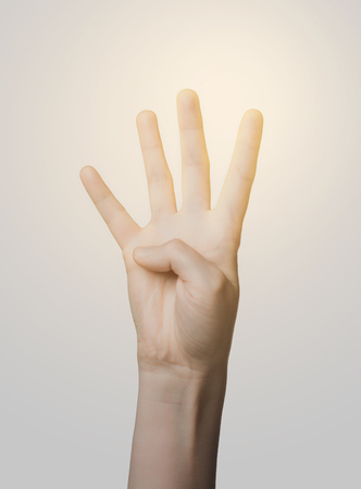 body parts: gesture, count and body parts concept - close up of hand showing four fingers