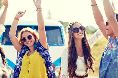 minivan: nature, summer, youth culture and people concept - happy young hippie friends dancing over minivan car outdoors