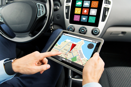gprs: transport, business trip, technology, navigation and people concept - close up of male hands holding tablet pc computer with gps navigator map on screen in car
