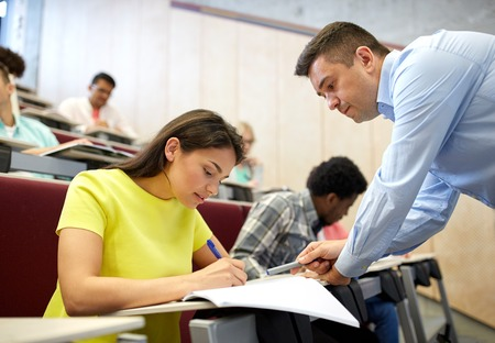 school exam: education, high school, teaching, university and people concept - group of international students and teacher at lecture hall