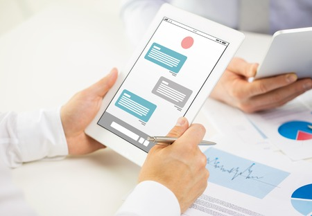 Messenger: business, people, technology, online communication and teamwork concept - close up of businessman hands with messenger on tablet pc computer screen at office