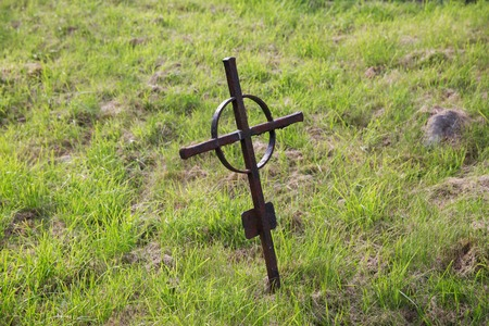 ancient ireland celtic cross: graveyard and burial concept - old rusty grave cross on celtic cemetery graveyard in ireland