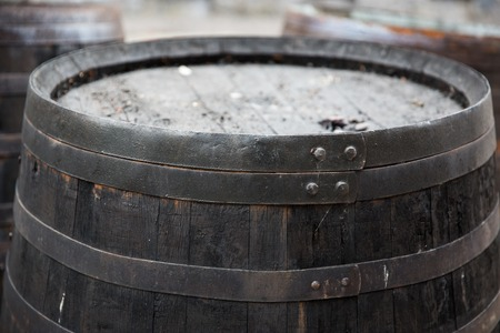 old container: storage, container and object concept - close up of old wooden barrel outdoors Stock Photo