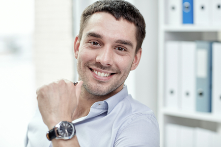 face work: business, people and work concept - portrait of smiling businessman face in office