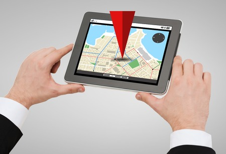 gprs: business, navigation, internet and technology concept - close up of man hands holding tablet pc computer with gps navigator map on screen