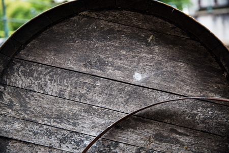old container: storage, winery, container and object concept - close up of old wooden barrel outdoors