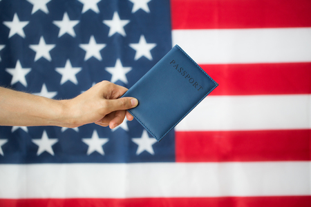 citizenship: citizenship, patriotism and nationalism concept - close up of hand with american passport