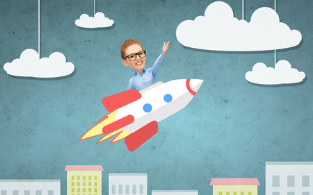 business, startup, development and people concept - businesswoman flying on rocket above cartoon city photo