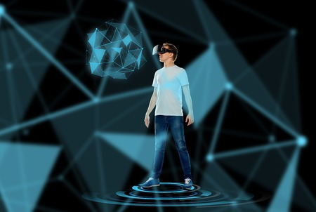 low glass: 3d technology, gaming, augmented reality, cyberspace and people concept - happy young man with virtual reality headset or 3d glasses looking at low poly shape hologram