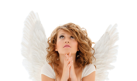 christmas prayer: religion, faith, holidays and people concept - praying teenage girl or young woman with angel wings over white background