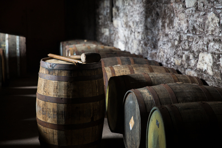 brewery: storage, container, winery, brewery and object concept - close up of old wooden barrel in wine cellar