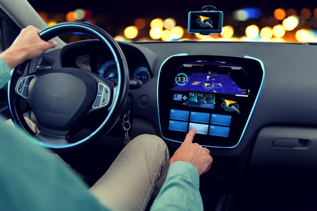 gprs: transport, destination, modern technology and people concept - close up of man driving car with navigation system on board computer