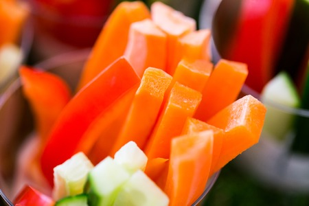 healthy eating, vegetarian food, diet and culinary concept - close up of chopped vegetable snack
