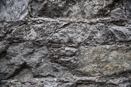rock texture: architecture, masonry, stonework and exterior concept - close up of old brick or stone wall background