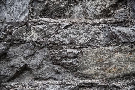 arquitectura, albañilería, cantería y exterior concepto - cerca de ladrillo o de fondo muro de piedra