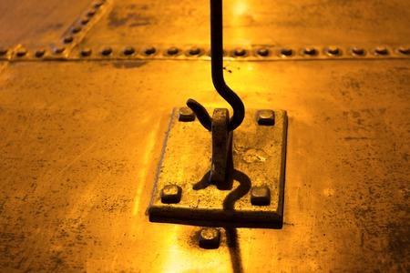 hook up: industry concept - close up of vintage metal hook and loop
