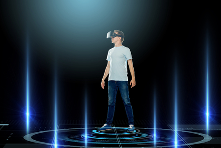 laser lights: 3d technology, gaming, augmented reality, cyberspace and people concept - happy young man in virtual reality headset or 3d glasses with laser lights over black background