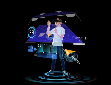 gprs: 3d technology, augmented reality, gaming, cyberspace and people concept - happy young man in virtual reality headset or 3d glasses with gps navigator projection over black background Stock Photo