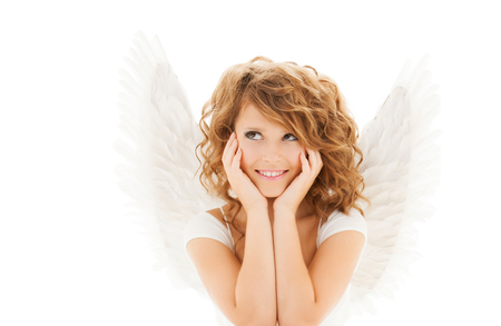 christmas woman: people, holidays, christmas and religious concept - happy young woman or teen girl with angel wings over white background Stock Photo