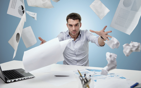 business, people, stress, emotions and fail concept - angry businessman throwing papers in office over blue background