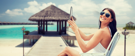 Stock Photo Summer Vacation Tourism Travel Holidays And People Concept Smiling Young Woman With Tablet Pc Computer Sunbathing In Lounge Or Folding