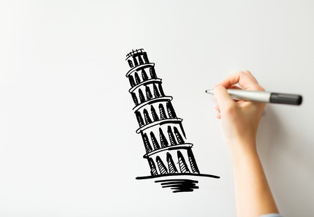 graphic arts: people, travel, tourism, graphic arts and architecture concept - close up of hand with marker drawing leaning tower of pisa sketch on white board or paper