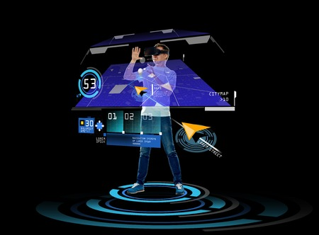 virtual technology: 3d technology, augmented reality, gaming, cyberspace and people concept - happy young man in virtual reality headset or 3d glasses with gps navigator projection over black background Stock Photo