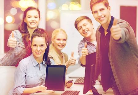 internet education: education, advertisement, techology and internet concept - group of smiling students with computer monitor and blank black tablet pc screen