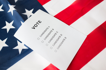 constituent: voting, election and civil rights concept - empty ballot or vote on american flag
