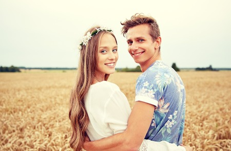 couple nu amour: summer holidays, love, romance and people concept - happy smiling young hippie couple hugging outdoors