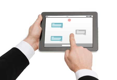 Messenger: business, people, internet, online communication and technology concept - close up of man hands holding tablet pc computer with messenger on screen