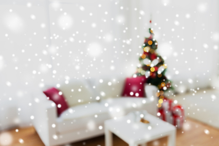 christmas backdrop: christmas, holidays, backdrop and interior concept - blurred living room with christmas tree background