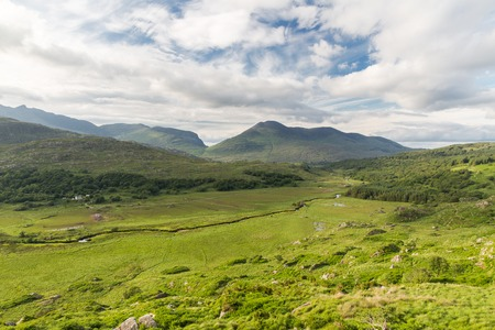 nature and landscape concept - view to plain with lake or river at Killarney National Park valley in ireland Stock Photo