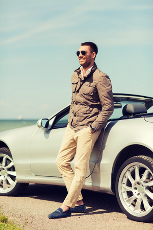 cabriolet: auto business, transport, leisure and people concept - happy man near cabriolet car outdoors