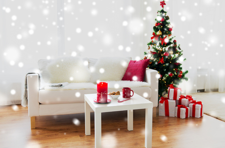 christmas, holidays, winter, home and still life concept - living room interior with christmas tree and gifts Stock Photo