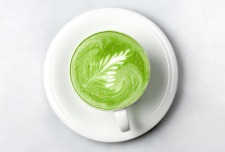 drink, diet, weight-loss and slimming concept - cup of matcha green tea latte over white Stock Photo