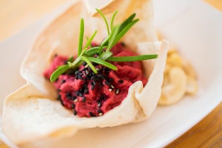 cornet: food, catering, cooking and eating concept - close up of dough cornet with beetroot filling Stock Photo