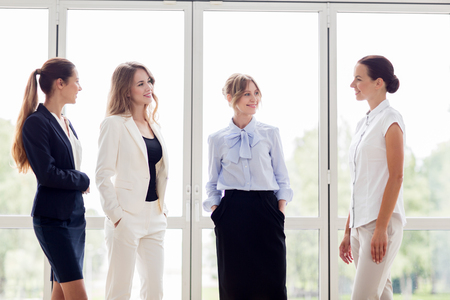 women business: people, work and corporate concept - business women meeting at office and talking Stock Photo