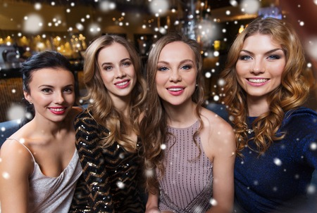 friends, bachelorette party, technology and holidays concept - happy smiling young pretty women taking selfie at night club Stock Photo