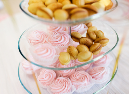 sweetstuff: food, junk-food, culinary, holidays and eating concept - close up of sweet custard dessert and cookies on glass serving tray