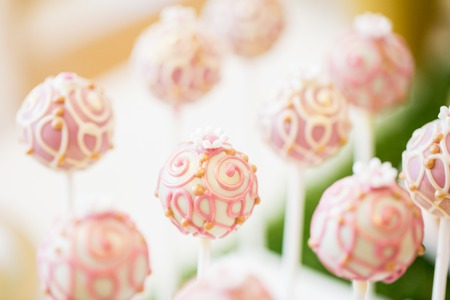 sweetstuff: food, sweets, junk-food, confectionery and eating concept - close up of cake pops or lollipops Stock Photo