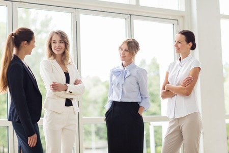 woman in office: people, work and corporate concept - business women meeting at office and talking Stock Photo
