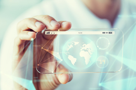 transparent globe: business, technology, science and people concept - close up of male hand holding and showing transparent smartphone earth globe projection Stock Photo