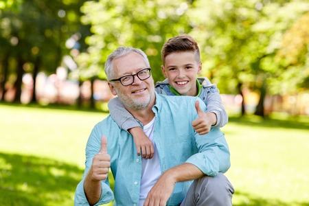 old man happy: family, generation, gesture and people concept - happy grandfather and grandson showing thumbs up at summer park