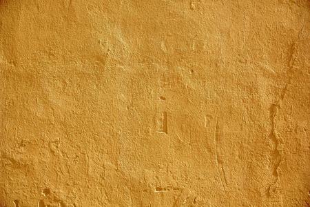 Achtergrond en textuur concept - geel geschilderde stenen muur oppervlak