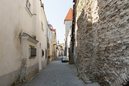 old street: travel, tourism and european architecture concept - old town street in tallinn city in estonia