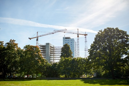 industry architecture: building, architecture, industry and engineering concept - crane at construction site building living house