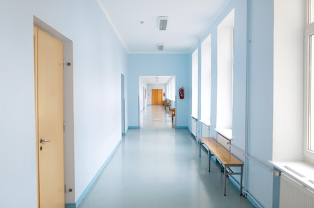 corridors: school, education and learning concept - empty school corridor Stock Photo